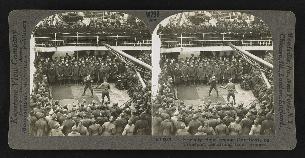 World War I soldiers returning from France aboard ship, two men boxing while crowd watches